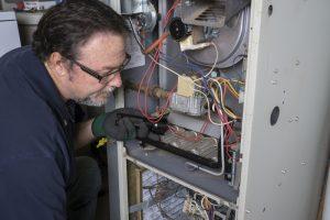 technician-examines-furnace