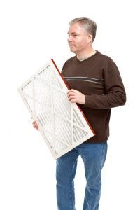 man-holding-furnace-filter