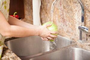 woman-washing-hands-at-sink